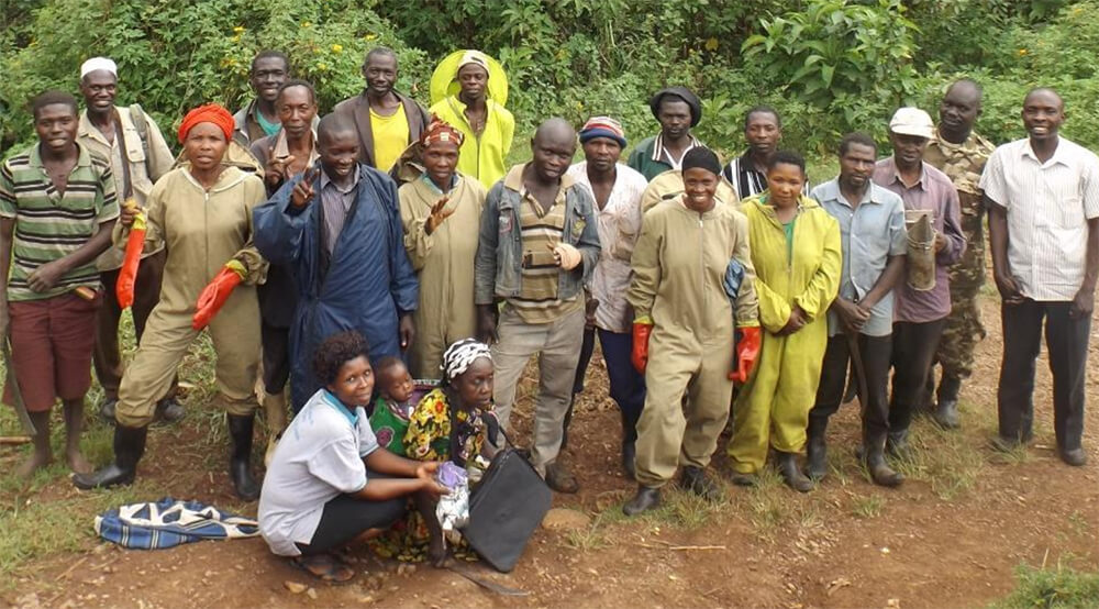 The Elgon Coffee Honey Cooperative bee keepers pose for the camera