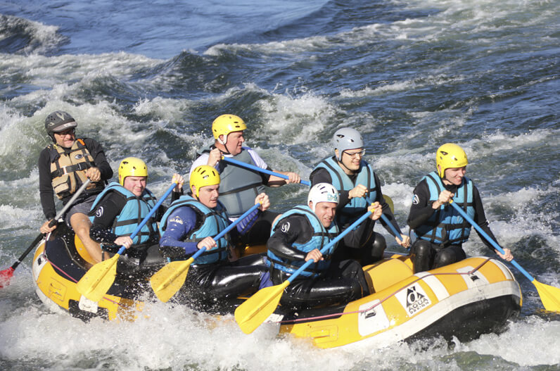 White water rafting - the concentration on their faces!