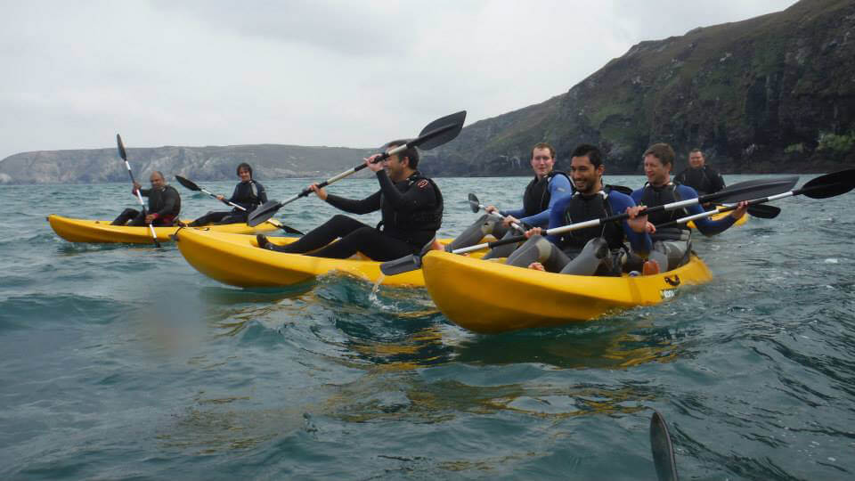 Smiling in the kayaks - this was before they capsized